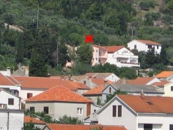 House on the sea in the town Pre Preko